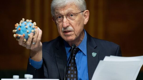 Director of the National Institutes of Health, Dr. Francis Collins, holds a model of the coronavirus as he testifies at a US Senate hearing to review Operation Warp Speed: the researching, manufacturing, and distributing of a safe and effective coronavirus vaccine, in Washington, DC, on July 2, 2020.