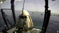 The SpaceX capsule sits aboard a recovery ship in the Gulf of Mexico.