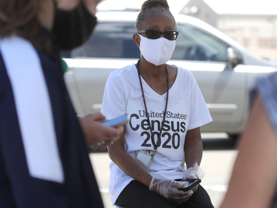U.S. Census Bureau worker Jennifer Pope wears a face covering at a walk-up counting site in Greenville, Texas, on July 31. The bureau is ending all counting efforts for the 2020 census on Sept. 30, a month sooner than previously announced, the bureau's director confirmed Monday. (LM Otero/AP)