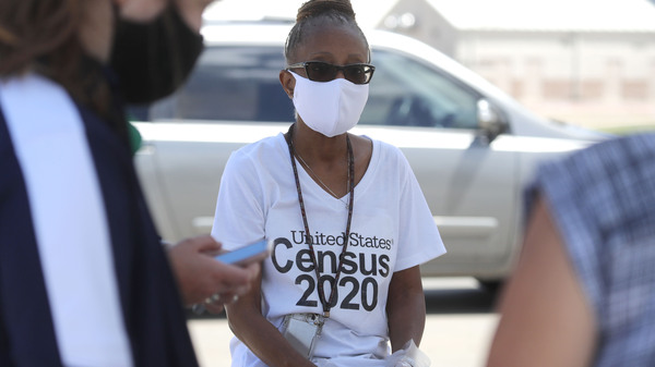 U.S. Census Bureau worker Jennifer Pope wears a face covering at a walk-up counting site in Greenville, Texas, on July 31. The bureau is ending all counting efforts for the 2020 census on Sept. 30, a month shorter than previously announced, the bureau