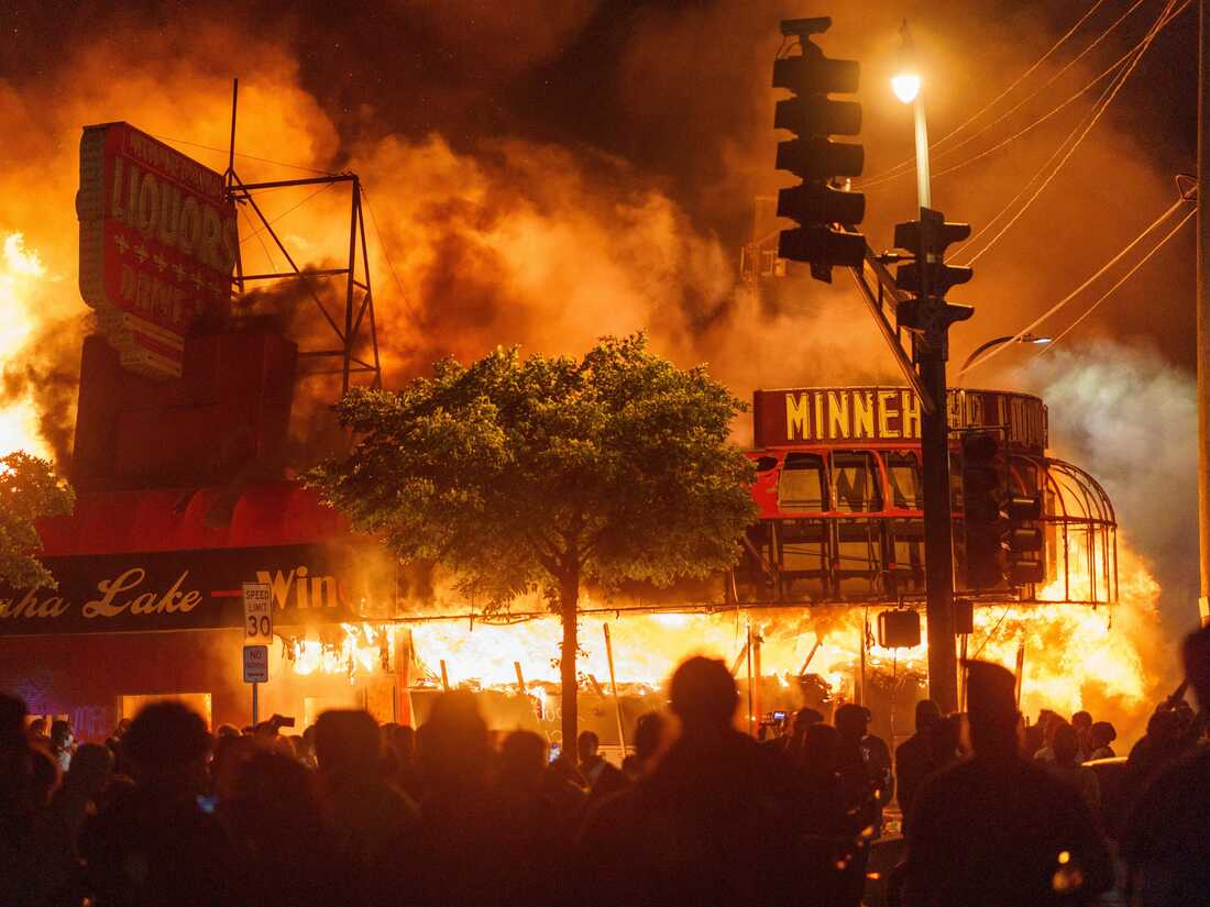 A liquor store in flames near the Third Police Precinct on May 28, 2020 in Minneapolis, Minnesota, during a protest over the police killing of George Floyd.
