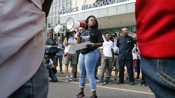 In this 2017 file photo, Cori Bush speaks on a bullhorn to protesters outside the St. Louis Police Department headquarters. Bush is projected to top longtime Rep. William Lacy Clay in Missouri