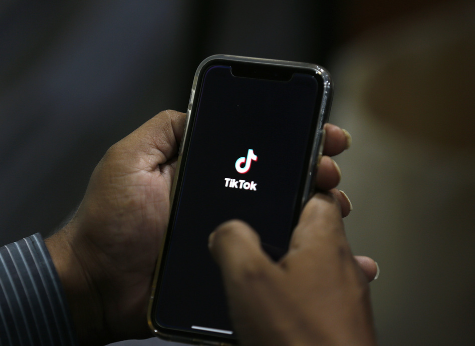Twenty lawsuits have been combined into a unified federal legal action against short-form video app TikTok over allegedly harvesting data from users and secretly sending the information to China. (Anjum Naveed/AP)