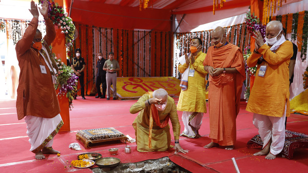 Indian Prime Minister Narendra Modi, center, performs the groundbreaking ceremony of a temple dedicated to the Hindu god Ram, watched by Rashtriya Swayamsevak Sangh (RSS) chief Mohan Bhagwat, right, and others in Ayodhya, India, on Wednesday.