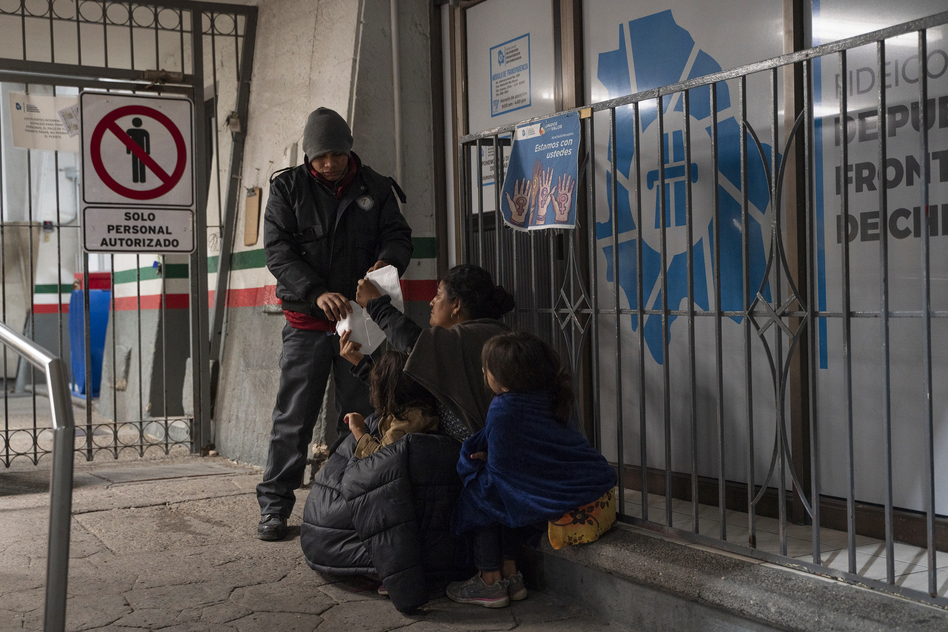A woman from Guatemala and her two daughters were apprehended upon crossing the U.S.-Mexico border between El Paso and Ciudad Juárez and were immediately expelled back to Mexico in the early hours of April 2 at the Paso del Norte International Bridge. (Paul Ratje)