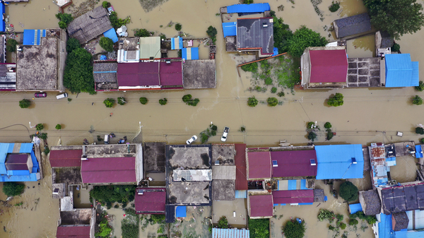 An aerial photo shows the extent of flooding in Guzhen Town of Lu