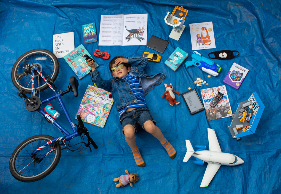 Elizabeth Dalziel's son Joe, 7, lays next to his favorite objects, toys and books as part of a homeschooling assignment — to create a time capsule — from his school in Berkhamsted, England. (Elizabeth Dalziel)