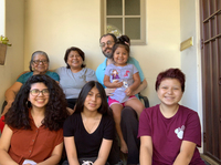 Maria Hernandez (top row, second from left) and her extended family live together in Los Angeles. When she was diagnosed with the coronavirus, she self-isolated in an upstairs bedroom.