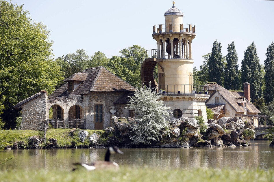 The Marlborough Tower is visible in the garden of Le Hameau de la Reine (The Queen's Hamlet), after it was restored, in Versailles, France. The hamlet was commissioned during the winter of 1782-1783 by Queen Marie Antoinette who wanted to move away from the constraints of the court of Versailles.