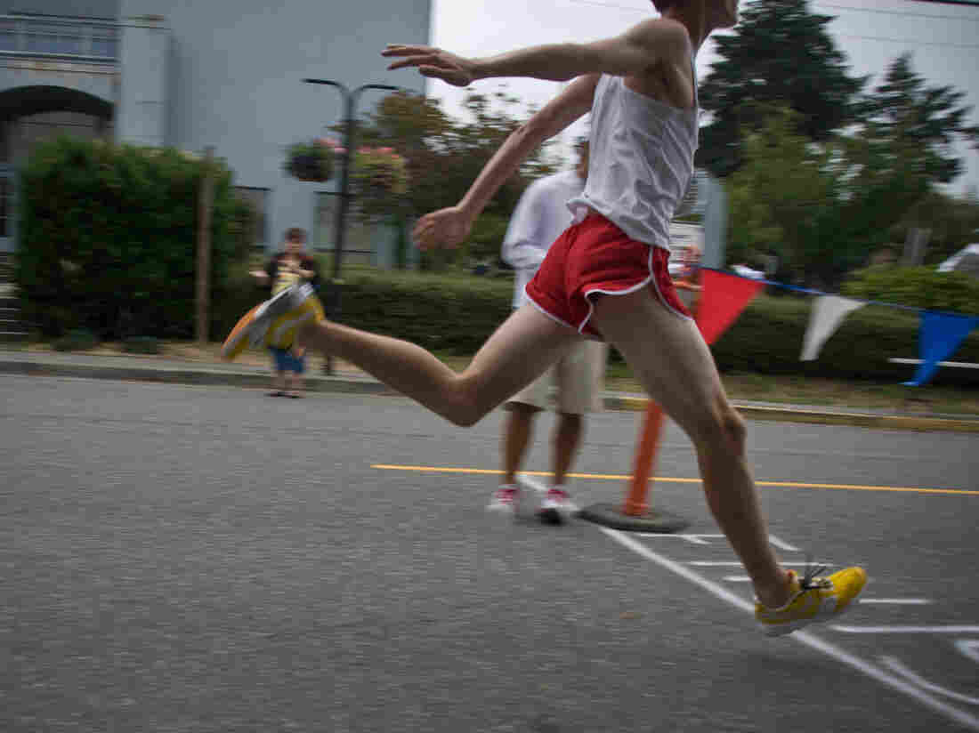 A runner crosses the finish line.