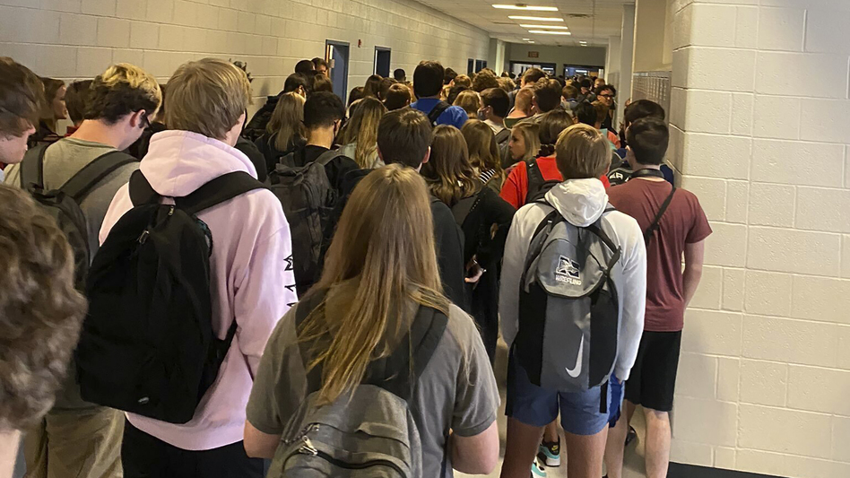 A photo posted to Twitter last week of a largely maskless crowd at North Paulding High School in Dallas, Ga., sparked a discussion about just how safe reopened Georgia schools really are. (Twitter via AP)
