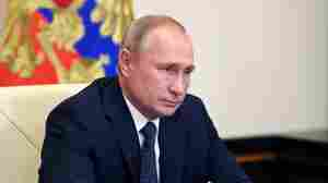 Skepticism Greets Putin's Announcement Of Russian Coronavirus Vaccine
