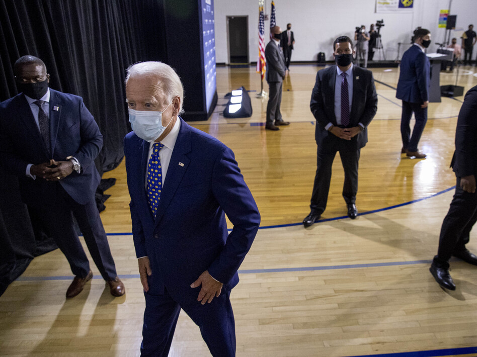 Former Vice President Joe Biden leaves a campaign event last month in Wilmington, Del. If Biden wins the election, he may face political pressure over what to do about President Trump. (Andrew Harnik/AP)