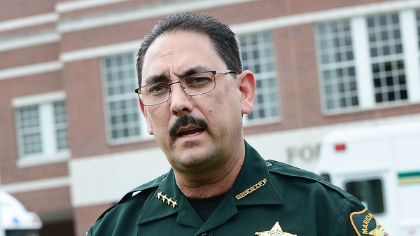 "Marion County Sheriff Billy Woods speaks during a press conference in Ocala, Fla., in 2018. Woods sent an email Tuesday informing the approximately 900 people working in the department that ""when you are on-duty/working as my employee and representing my Office – masks will not be worn,"" the Ocala Star-Banner reports."