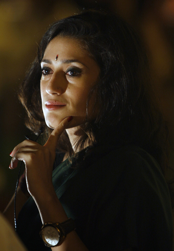 """Fatima Bhutto says it was """"totally terrifying"""" to go through airport security with her laptop full of research material for The Runaways. """"You know, 'I'm writing a novel' is kind of like 'my dog ate my homework,' I think, at an airport,"""" she says. Bhutto is pictured above in New Delhi in April 2010."""