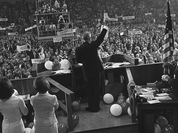 On July 16, 1964, Barry Goldwater waves to delegates inside the Cow Palace at the Republican National Convention in San Francisco. He claimed the GOP presidential nomination at a convention soured with party divisions, all aired on television.