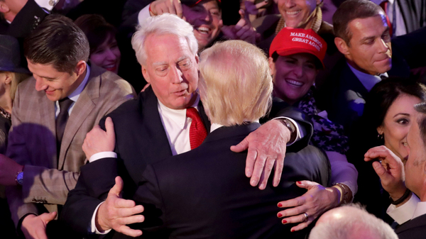 Republican president-elect Donald Trump hugs his brother Robert Trump after delivering his acceptance speech at the New York Hilton Midtown in the early morning hours of Nov. 9, 2016, in New York City.