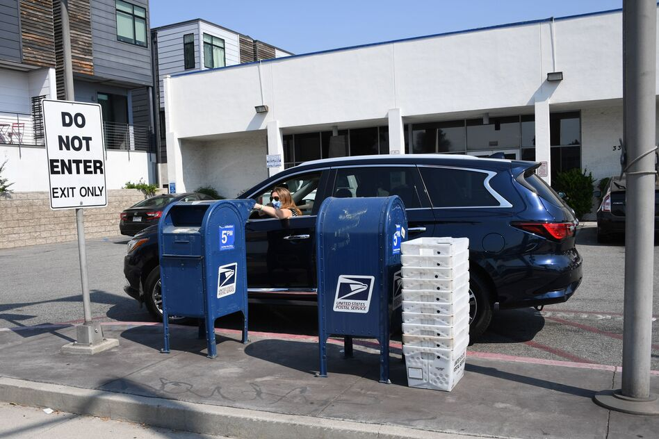 With voting by mail set for a major expansion because of the pandemic, some worry that thousands of absentee ballots could be rejected because the Postal Service may not postmark the envelope. (Robyn Beck/AFP via Getty Images)