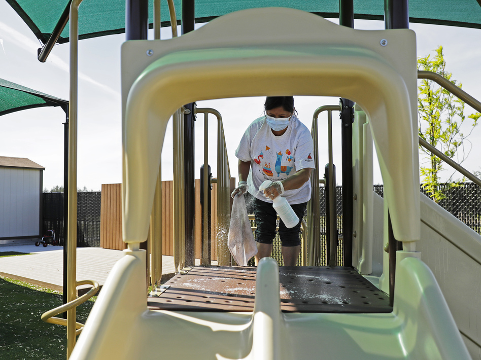Ninety-five percent of child care providers are women, and many are losing their jobs as the pandemic devastates the industry, the National Women's Law Center says. (Ted S. Warren/AP)