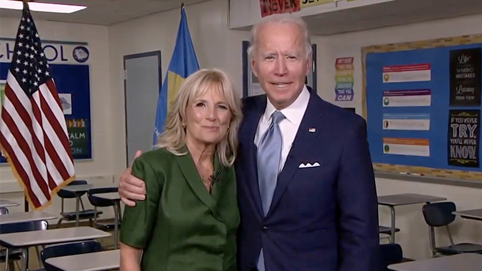 Democratic presidential nominee Joe Biden joins his wife Jill Biden in a classroom after her address to the virtual Democratic National Convention on Tuesday. (Screenshot of DNCC livestream via Getty Images)