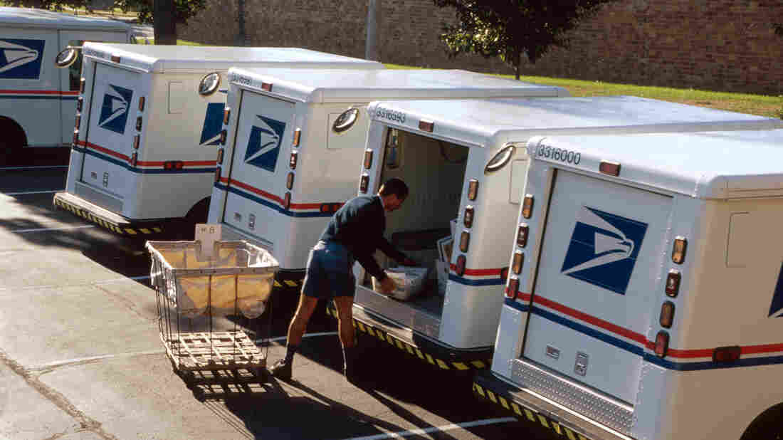 US Post Office, mail carrier loading truck.