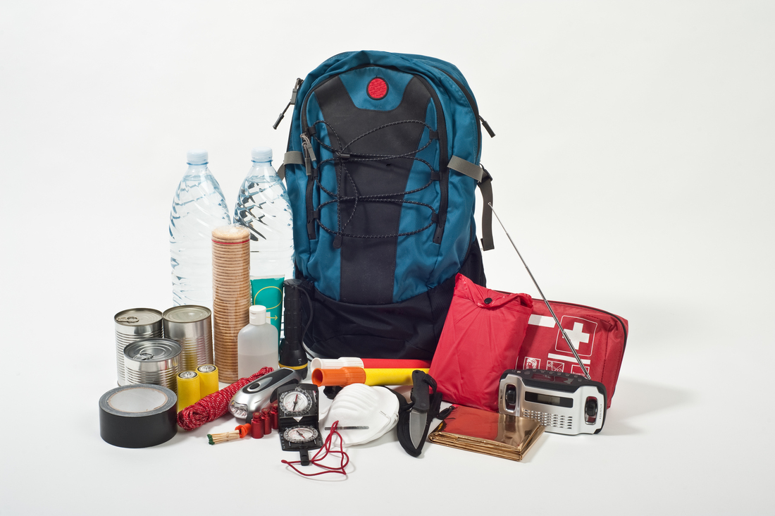 A bag including supplies like a battery and canned food just in case people evacuate during a hurricane.