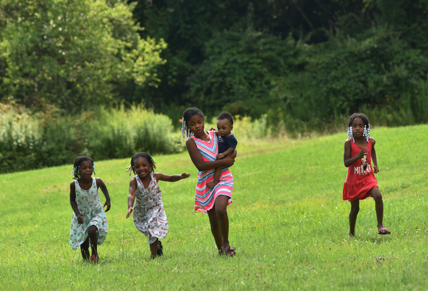 Kwanasia Ginyard (left), Gianna Bridges, Kamani Minton, Shevin Fanklin, Jr., and Micaela Johnson play in their great-grandfather's yard during his 85th birthday celebration.