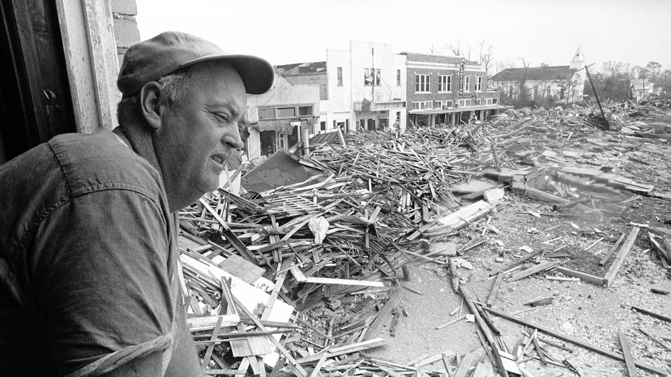 Parnell McKay, the civil defense director of Pass Christian, Miss., looks over the town's main business district on Aug. 23, 1969 after Hurricane Camille passed through. (Jack Thornell/AP)