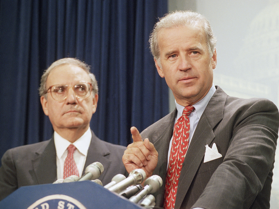 Then-Sen. Joe Biden (right) speaks at a Capitol Hill news conference in 1994 after the Senate voted on a major crime bill. (John Duricka/AP)