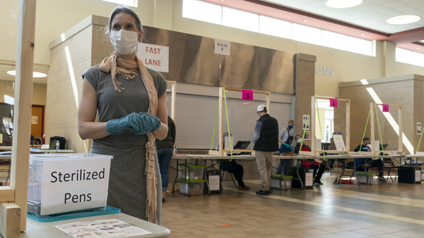 A poll worker in Sun Prairie, Wis., is seen during the state