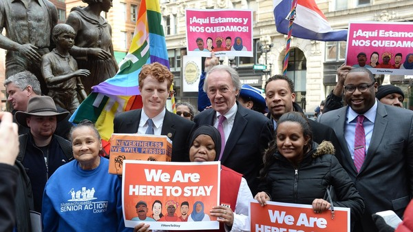 U.S. Rep. Joe Kennedy III (D-Mass.), center left, and Sen. Edward Markey (D-Mass.), center right (R) during a 2017 protest against Trump administration immigration policies. The two lawmakers face each other in a Democratic primary this Tuesday.