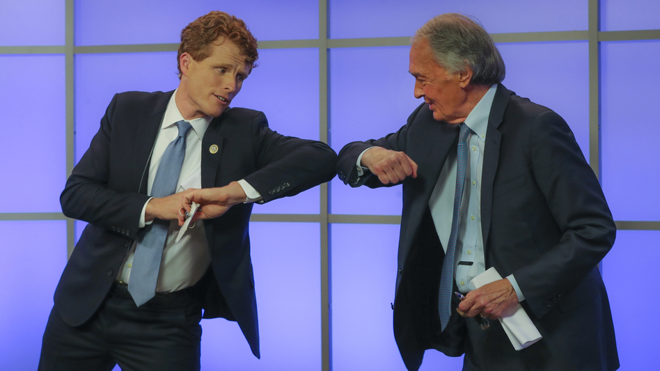 Rep. Joe Kennedy III (left) bumps elbows with Sen. Ed Markey after their Democratic Senate primary debate on June 1 in Springfield, Mass. (Matthew J. Lee/The Boston Globe via AP/Pool)