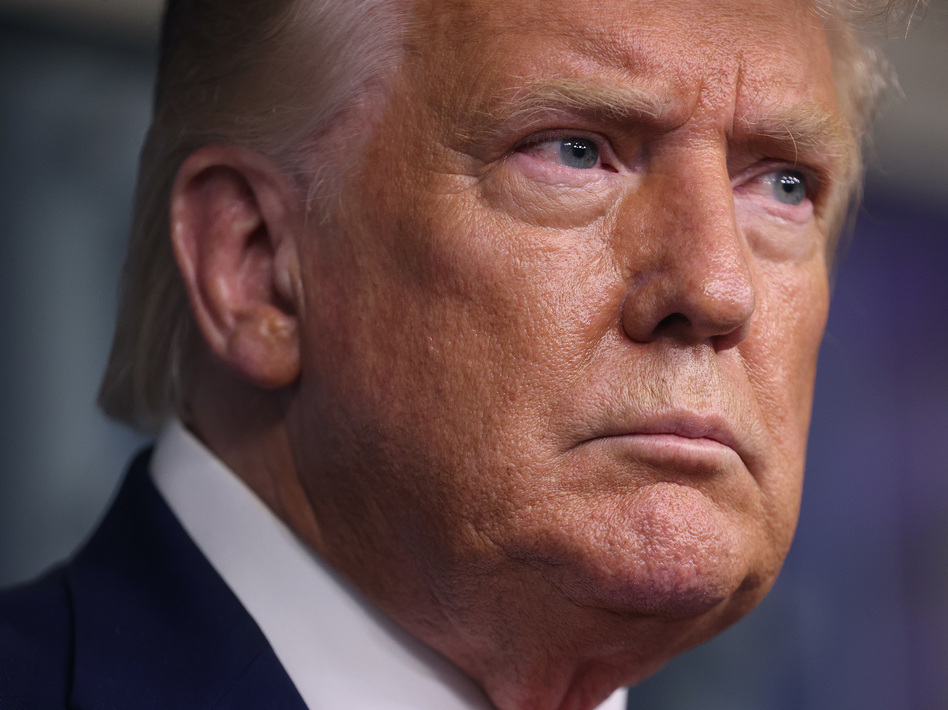 """President Trump plans to visit Kenosha, Wis., on Tuesday """"to see the people that did such a good job for me"""" during the protests. He will not be meeting with Jacob Blake's family. (Win McNamee/Getty Images)"""