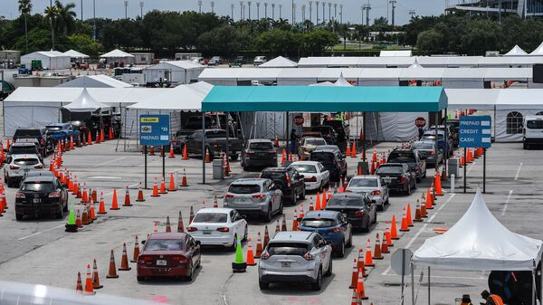 Cars line up last month at a rapid coronavirus testing site at Hard Rock Stadium in Miami Gardens, Fla. Florida