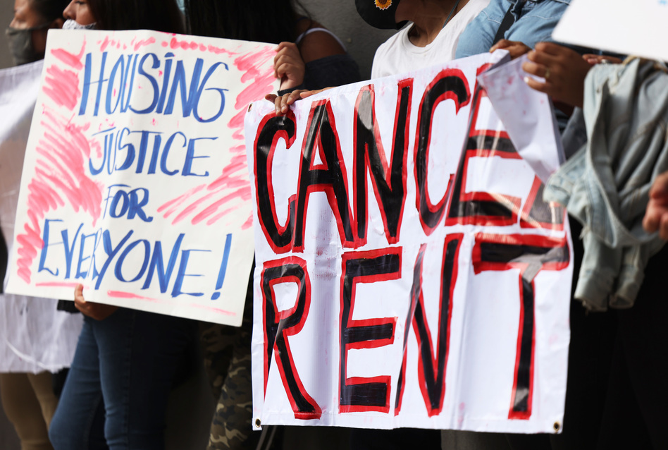 Demonstrators hold up signs as they gather at Brooklyn Housing court during a 'No Evictions, No Police' national day of action in New York City. (Michael M. Santiago/Getty Images)