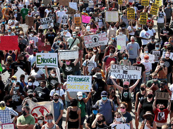 People march in support of Jacob Blake and his family to the Kenosha County Courthouse in Kenosha, Wis., in August.