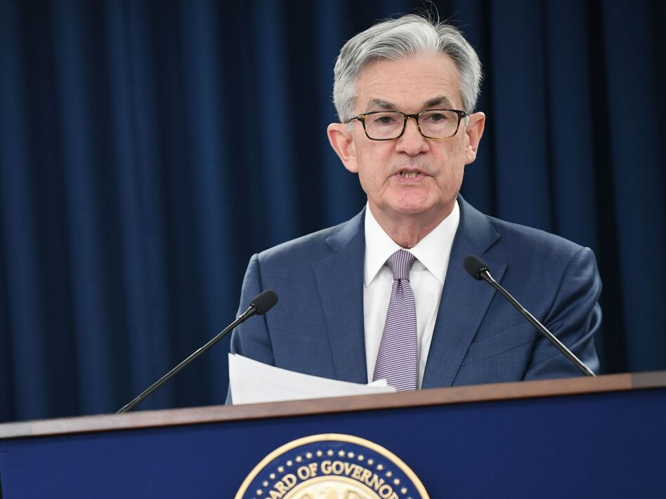 Federal Reserve Chairman Jerome Powell speaks to reporters in March in Washington, D.C. In an interview Friday with NPR, Powell said it may take years before the economy has fully recovered. (Eric Baradat/AFP via Getty Images)