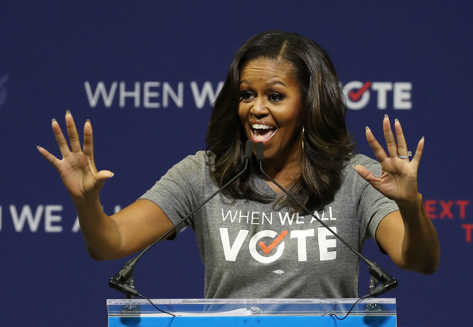 Former first lady Michelle Obama, seen here at a rally in 2018, is the founder of When We All Vote, an organization that aims to help people register and vote. (Joe Raedle/Getty Images)