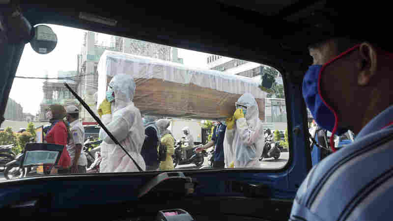 Can A Parade Of Coffins Scare People Into Wearing Masks?