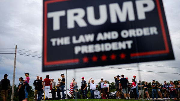 Supporters of President Trump line PA-981 outside of Arnold Palmer Regional Airport to get into a Sept. 3 rally in Latrobe, Pa.