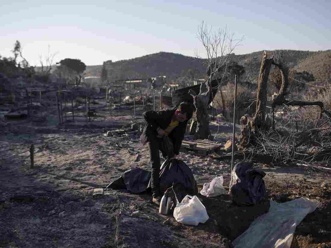 Greek police fire teargas at migrants on Lesbos island