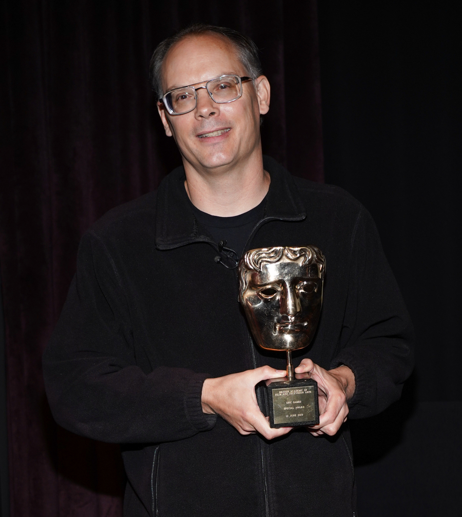 Tim Sweeney is awarded during the BAFTA Presents Special Award to Epic Games in June 2019. He tells NPR he is suing Apple and Google in a bid to attack practices he claims are monopolistic and exploitative. (Rachel Luna/Getty Images)