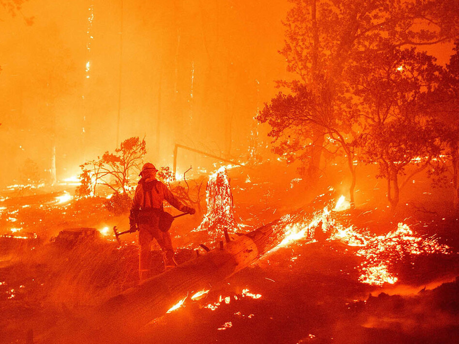 Wildfires across the West, such as the Creek Fire here in Madera County, Calif., are pushing firefighters to their limits. (Josh Edelson/AFP via Getty Images)