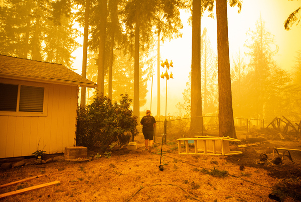 Chelsea DeVos scrambles to salvage possessions from her home as the Santiam Fire approaches near Gates.