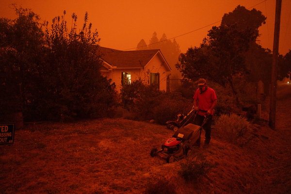 Kyle St. Clair prepares to evacuate from his home Wednesday in Molalla, Ore.