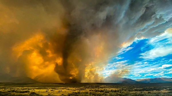 A funnel appears in a thick plume of smoke from the Loyalton Fire in Lassen County, Calif., Saturday, Aug. 15, 2020.