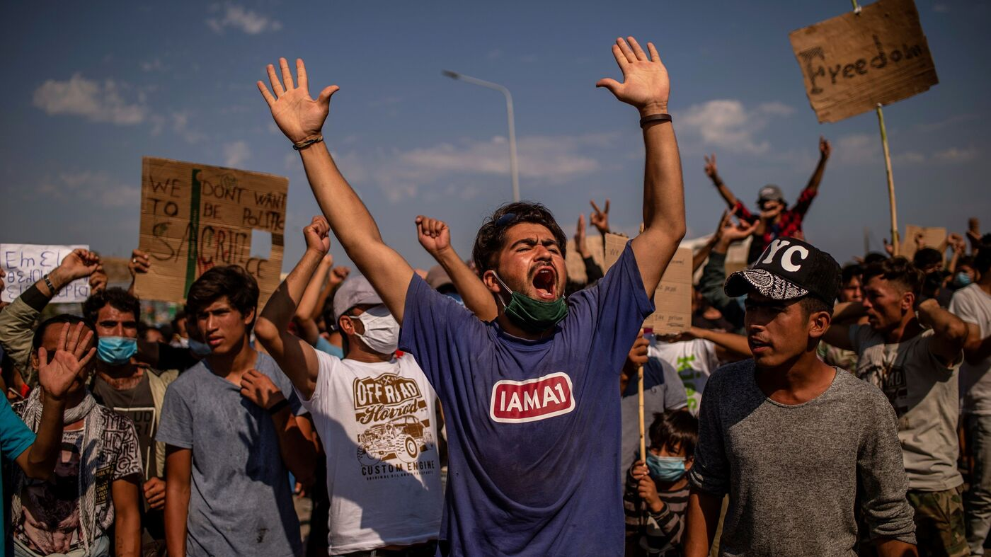 Police Fire Tear Gas At Refugees Protesting To Leave Greek Island thumbnail