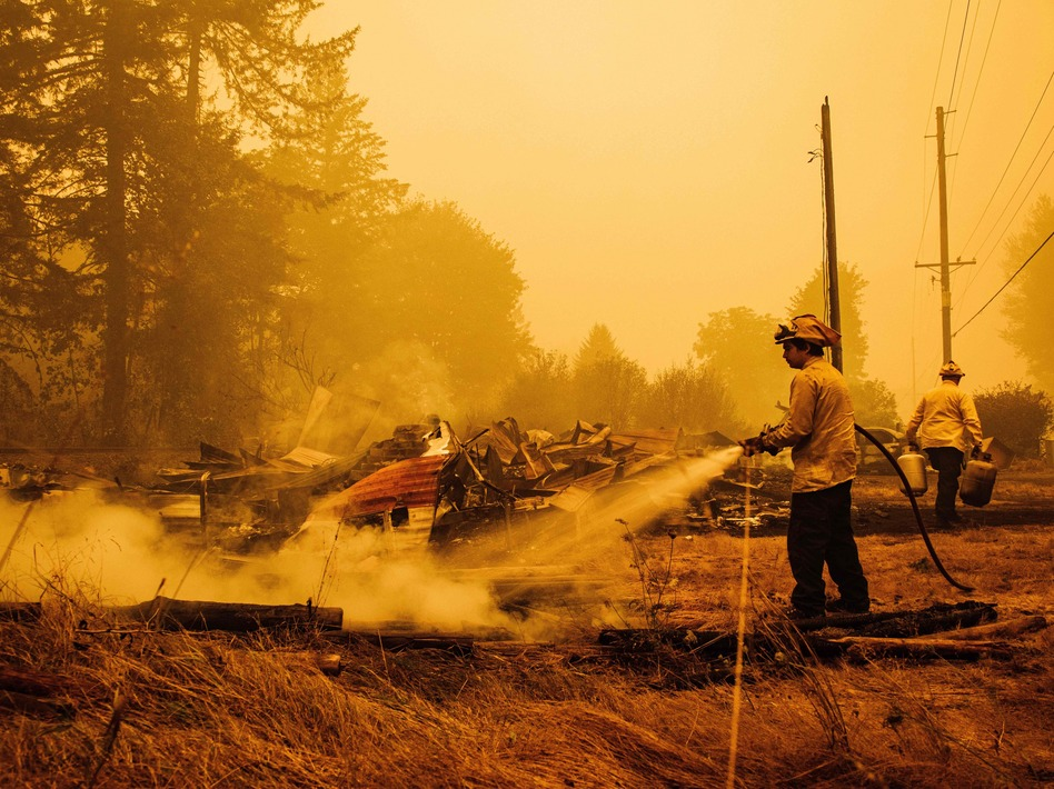 Oregon firefighters put out embers in Mill City, Ore., on Sept. 10, 2020, as they battle the Santiam Fire. As fires ravage the Pacific Northwest, fear and rumors have taken hold on social media. (Kathryn Elsesser/AFP via Getty Images)