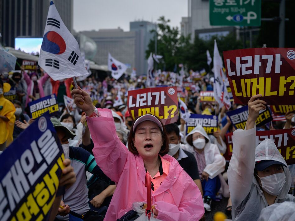 Members of conservative right-wing and Christian groups take part in an anti-government rally in Seoul on Aug. 15. (Ed Jones/AFP via Getty Images)