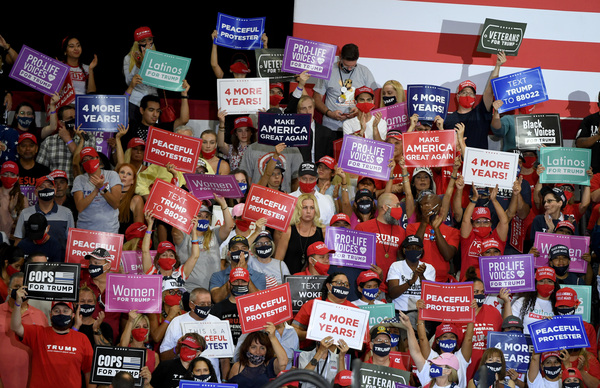 Supporters of President Trump hold up signs during an indoor campaign event for him on Sunday in Henderson, Nev. Nevada is a state that Democratic presidential candidate Hillary Clinton won in 2016 but that Trump is trying to flip.